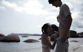 Asian cutie is unclean a complete stranger at burnish apply beach