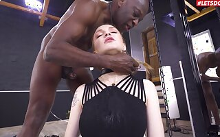 Gagged redhead pumps serious BBC into her tight little holes