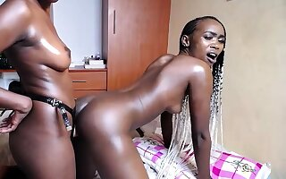 Three hot African girls fuck each outer with strapon continue at