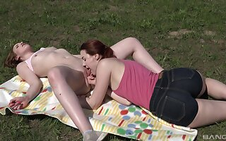 Lovely lesbian romance on the grass for two teens