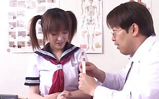 Uniform-clad Asian teen with pigtails getting her wet pussy fingered