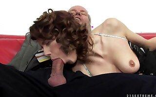 A cute redhead fingers an old man's ass hole