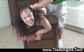 Brunette teen Eva gets tied up over a dresser for better pussy abuse